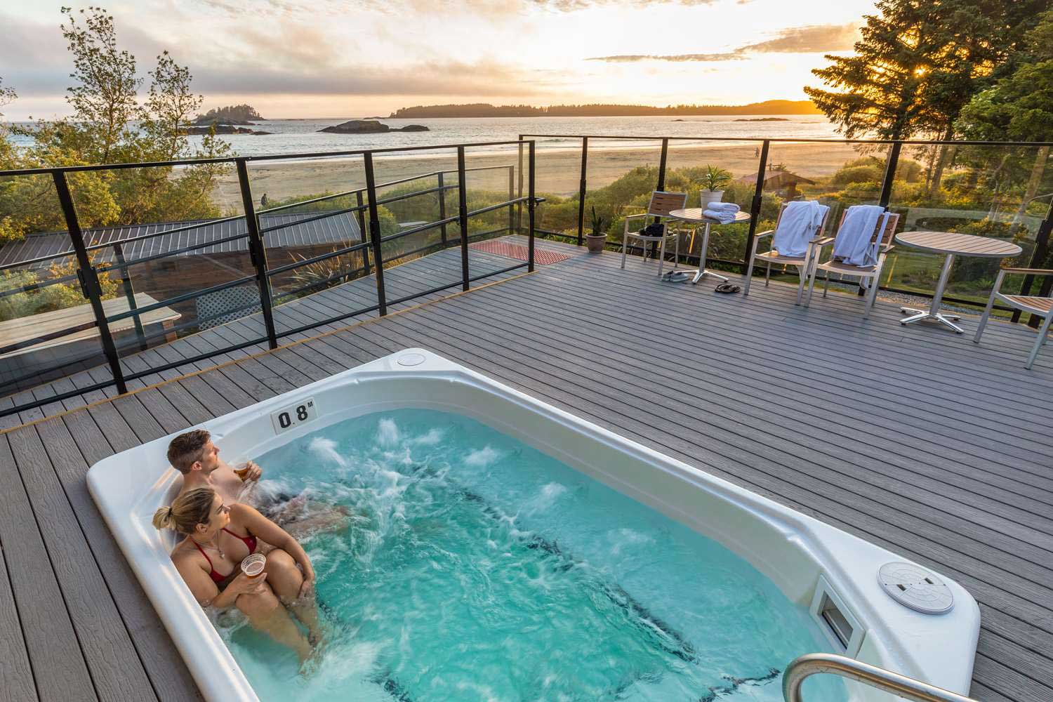 Soaking in a beachside hot tub on a wellness package in Tofino.