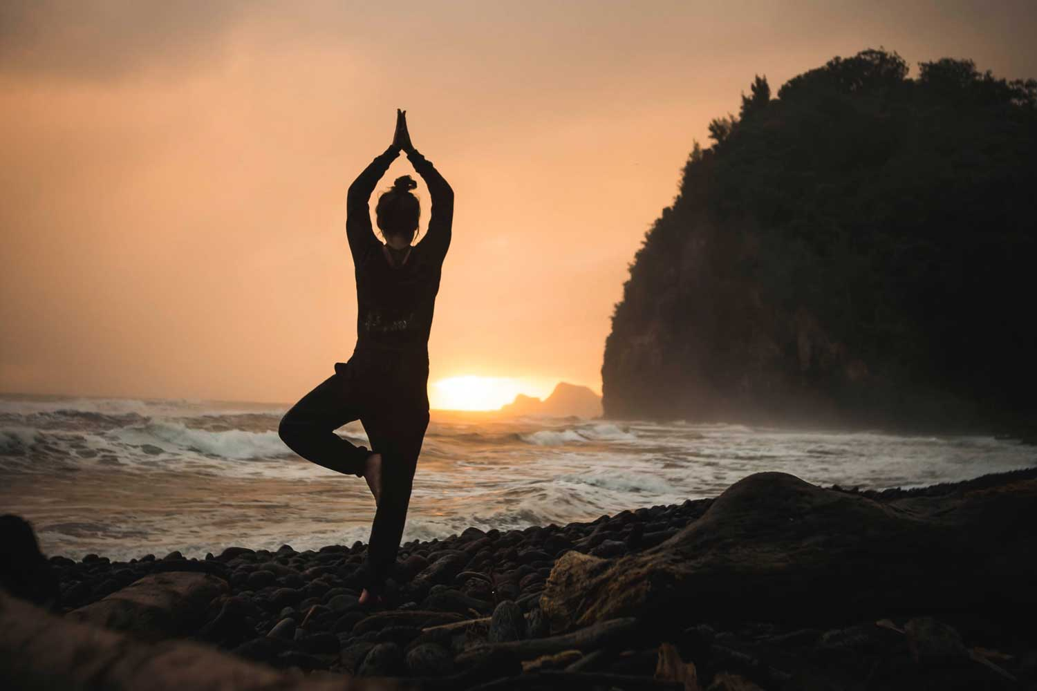 Person doing yoga on a retreat deal in Tofino.